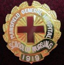 Image of Mansfield General Hospital School of Nursing pin 1931-2001. - Nursing pin