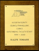 Image of Award wooden plaque with attached gold colored metal plate.  Has logo of As