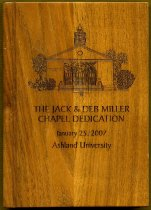 Image of Award wood, in the shape of a book.  with lettering as follows The Jack and Deb Miller Chapel Dedication January 25, 2007 Ashland University.  Has logo/image of the chapel. - Award