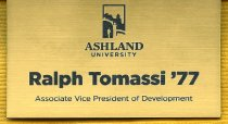 Image of Gold colored name tag with black colored lettering as follows: Ralph Tomassi '77 Associate Vice President of Development.  Has Ashland University logo. - Name tag