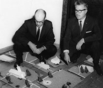 Image of Al Fenton with Dr. Glenn Clayton reviewing master building plan for the Ash