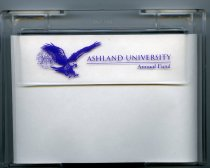 Image of Plastic note paper holder with Ashland University Annual Fund used as a lable.  Noteholder contains paper. - Objects Collection