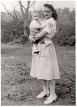 Image of Margaret Robinson wearing uniform, September 1945 (holding Mary McMillen)