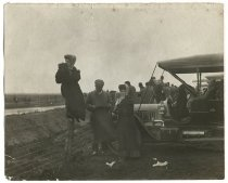 Image of Alice Austen photographing an automobile race, ca. 1908