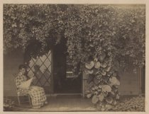 Image of Alice Austen on porch of Clear Comfort, ca. 1884-1886
