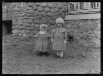Image of Rita & Sara Holcombe standing in front of house - Negative, Film