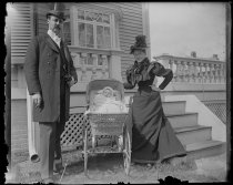 Image of Mr Richards, Lou, & baby in carriage - Negative, Glass-plate