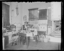 Image of Laboratory upstairs, Fred at work, photo by Alice Austen, 1901