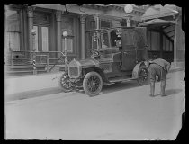 Image of [Man inspecting a taxicab] - Negative, Glass-plate