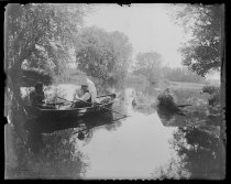 Image of Mr. Munroe and Nellie in boat, photo by Alice Austen, 1892