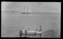 Image of Bathers in boat in front house - Negative, Glass-plate