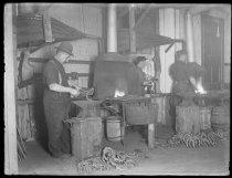 Image of O'Connor's blacksmith shop, interior large - Negative, Glass-plate