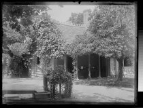 Image of Back of house & table of flowers - Negative, Glass-plate