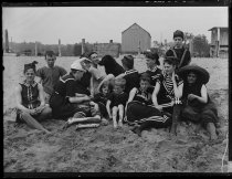 Image of Group of bathers sitting on the sand, photo by Alice Austen, 1886
