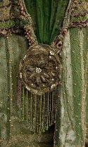 Image of detail of medallion on skirt