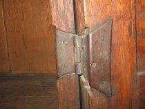 Image of detail, hinge inside cabinet door