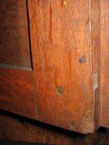 Image of detail, interior of cabinet door