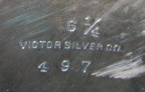 Image of detail, mark on base