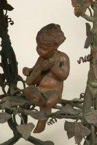 Image of detail of cherub sculpture
