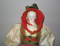 Image of detail, doll's head and shoulders