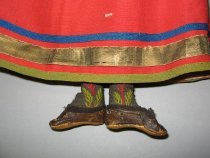 Image of detail, doll's feet