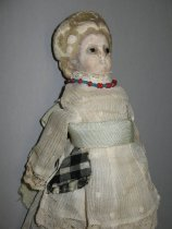 Image of 3/4 front view, doll's head and upper body