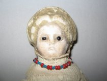 Image of detail, doll's face