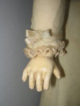 Image of detail, doll's hand