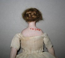 Image of back view, doll's head and shoulders