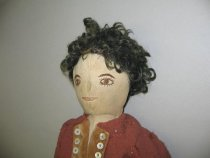 Image of 3/4 front view, doll's head