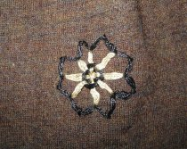 Image of detail, embroidered flower