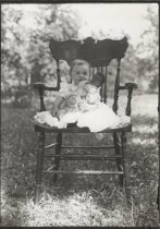 Image of Marjorie, sitting on the big arm chair, photo by Coleman Benedict, ca. 1902