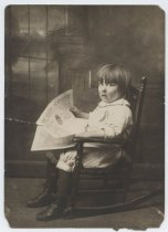 Image of Young child in a rocking chair, photo by George Bear, ca. 1915