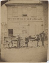 Image of [Brisk's Express wagon and building] - Print, Photographic