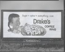 Image of Billboard for Drake's Coffee Ring, photo by Herbert A. Flamm, 1955