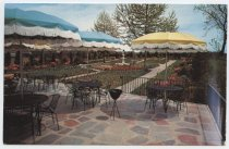 Image of The beautiful gardens and patio at Henny's Steak House - Postcard