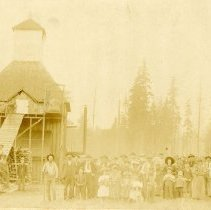 """Image of Print, Photographic - Copies: 1 ( 1 copy)   """"Sep       American County across the river from Newberg, Ore. around 1900.  Half way from St. Paul Ore. Hop picking time. - - Family, neighbors & friends turned out in those days, some people camped & made a """"vacation with pay"""" out of it. It was sort of merry time for kids, usually they had a quota to pick then they were  allowed to play. Families were together. women exchanged ideas & recipes, men sized up & guessed on the crop turn out & al such things pertaining to their vicinity. women  worked hard under NO conveniances, such  as trying to can applesauce while they could get apples, etc. during hop picking time. +C.F. Yeager Christopher Fred Yeager's Old Hophouse. grandfather of Norman Yeager."""" (back; written by Florence Ray Yeager)"""