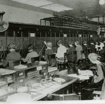 """Image of Print, Photographic - Copies: 2 ( 2 copies with associated paper insert and envelope)  \ """"1924 telephone"""" (associated envelope)   """"The Salem telephone office located at 160 N. Liberty. There were 14 manual switchboards postions at the time.  1924 Photo Courtsey of  Shirley Doerfler."""" (associacted paper insert)"""