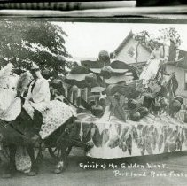 """Image of Print, Photographic - Copies: 2 ( 2 copies with associated envelope)   """"Spirit of the Golden West. Portland Rose Festival - 1909."""" (front of image)  """"Salem Cherrians Float at  Portland Rose Festivale - 1909. Miss Agnes Gilbert, Cherry Fair Queen."""" (associated envelope)"""