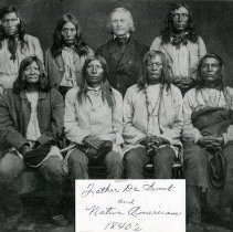 """Image of Print, Photographic - Copies: 1 ( 1 copy)   """"Father De Smet and  Native Americans 1840's"""" (front of image)  """"_esuits & the Indian Wars N.I. Burns, S.J. Indian Chiefs brought in by Father De Smet for trial of Peace-Making before General Harney - - - Back - l to R. Denis Kettte Falls    Bonaventura Coeur d'Alene  Father Pierre De Smet { Francis Iroquois (Burns) F.X. Flathead (O.H. Libe) - - Front, seated, l to r - Victo Kalispel  Alexander Pen d'Oreille Adolphe { Flathead (Burns)  Iroquois    Andrew Seltis Coeur d'Alene (O.H.Libe) Kualualsli  (Couer d'A) Spokane Garry - absent"""" (back)   *Tagged Adolph under both Flathead and Iroquois since his name was followed by both.*"""