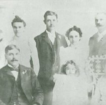 """Image of Print, Photographic - Copies: 3 ( 3 copies)   """"Left to right - front row --- Paine --- child of Paine Agnes Kittson ( wife of Paine) Top Row - relatives of Paine - names unknown -"""" (back of one copy)"""