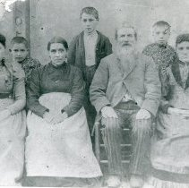 "Image of Print, Photographic - Copies: 1 ( 1 copy)  ""The Patriarch - Roc Pichet, Vicotoire Depsard and family. [typed] - - - Roc Pichette & Family"" (back)"