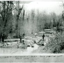 """Image of Print, Photographic - Copies: 1 (1 copy)  """"Logging near Horseshoe Lake. Louis Ernst on left About 1900"""" (front)"""