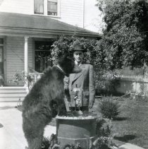 """Image of Print, Photographic - Copies:1 (1 original)  """"Pet Bear and John A. Gearin in front yeard of Old Gearin Home"""" (back)"""