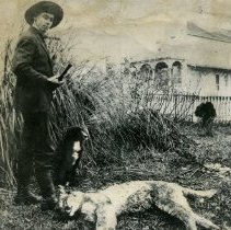 """Image of Print, Photographic - Copies: 1 (1 copy)  """"Ike Gervais and his dog, Nig, with a cougar he killed on the Hamilton Ranch in Flourify Valley  Feb. 1910. """" (back)"""