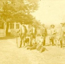 """Image of Print, Photographic - Copies: 3 (1 original on mat, 1copy, 1 photocopy)  """"Taken at Champoeg in front of the Jette house L-R. Frank Lambert Emil Van Damme ____ Le May Frank Osborn - unknown"""" (back of copy)"""