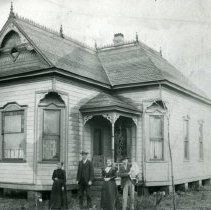 """Image of Print, Photographic - Copies:  3 (3 copies)  """"Mrs. (Galloway) McDonald, Cy McDonald, Mrs. Emmet (Agatha McDonald) Kirk, Emmet & Lorin Kirk.  1890s.  Store on left side (mercantile and post office)  Maria Galloway born 1834 died 1907 Sebastion McDonald 1873-1948"""" (back of one copy)  """"Old times - St. Paul..... - - 1890 Emmet Kirk House"""" (back)"""