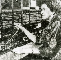 """Image of Print, Photographic - Copies: 1 ( 1 copy with associated envelope)   """"Retiring after 38 years as a Salem telephone operator, Miss Ella Lovre is shown at her switchboard in the  Pacific Telephone office at 740 State St. On July 16, 1920, operation numbered 19. At this date in 1958  the number has grown to 170. (Statesman Photo 3-28-58) - Number Please"""" ( associated envelope)"""