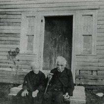 """Image of Print, Photographic - Copies: 1 (1 copy)   """"McMillan, Wm. (1800-1903): Metis, son of James McMillan (Nor'Wester and HBC Chief Factor), buffalo hunter at Fort Edmonton, settled at Red River in 1830's - shown with wife Margaret Dease (1818-1912) - taken at their home (now part of Assiniboia Park) shortly before his death in 1903 at the age of 103. """" (back)"""
