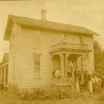 """Image of Print, Photographic - Copies: 8 ( 1 original on mat, 1lamenated copy, 6 copies)  """"The Murphy House"""" (front of original)  """"Murphy House 1903 picture"""" (front of lamenated copy)  """"On balcony, Agnes, left to right on porch Nellie, Susan, Minnie, Lottie,  Damian, and Bessie. on steps James C. Murphy and Wife Elizabeth (Kirk) Murphy and son Peter Murphy and 2 unidentified people photo 1905."""" (back of one copy)"""